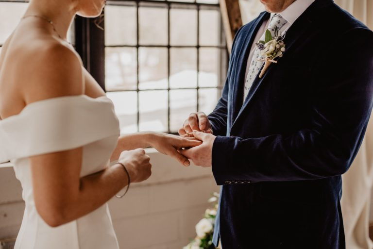 woman-and-man-holding-each-others-hands-2253842